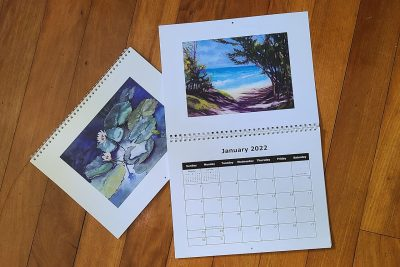 2022 art calendar with a different painting on each month by Maui artist Christine Waara